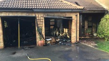 Firefighters save house as blaze destroys double garage