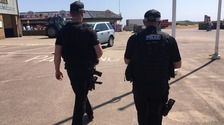 Armed officers out on patrol on Skegness seafront.