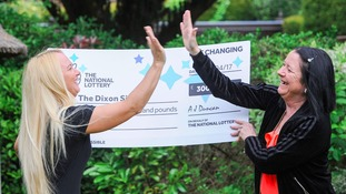 Two sisters from Solihull won £300,000 on a scratchcard, only to accidentally rip it half as they jumped for joy.