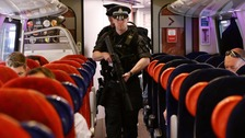 Armed police patrol trains for first time after attack