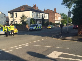 Police have set up a cordon near Wigan Lane.