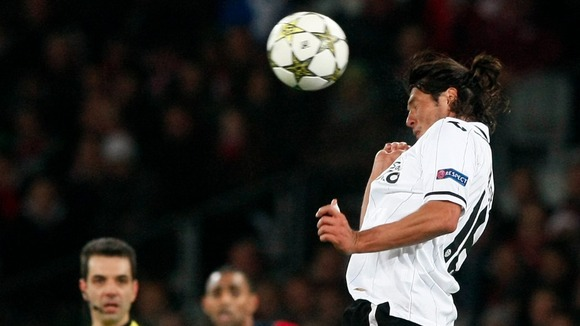 Valencia forward Valdez heads the ball during the Group F match against Lille