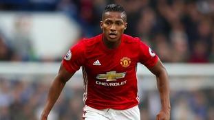 Man United full-back Valencia pens new deal