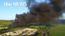 Fire crews damping down after huge fire in Sussex