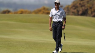Obama wows crowd as he tees off Scotland visit with game of golf