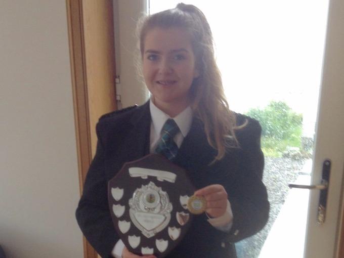 Eilidh MacLeod displays her bagpiping award