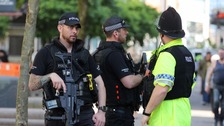 Further arrests and tighter security as armed police protect Bank Holiday events