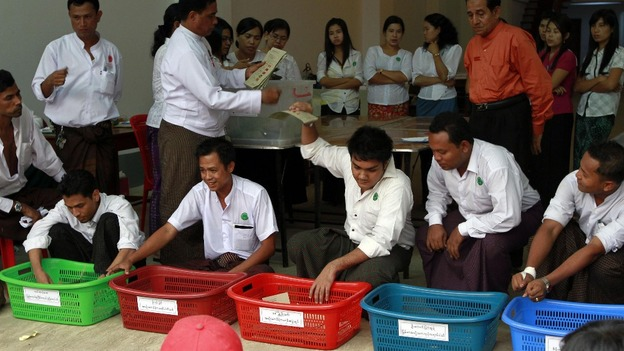 Officials count votes at a polling station in Dagon township in Yangon.