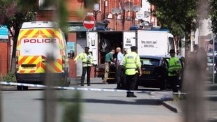 Police at the scene in Moss Side.