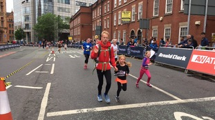 Parents run with their children during the Junior and Mini Great Manchester Runs
