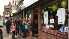 Queues outside a tattoo parlour in Flixton, Greater Manchester