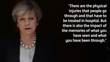 May tells of 'harrowing' visit to Manchester victims