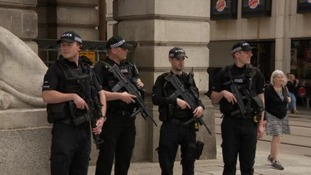 Armed police patrol streets for extra security measures