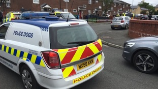 Raids were carried out in Moss Side on Sunday