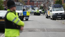 Two arrests as police carry out searches across Manchester