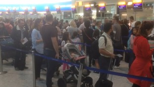 Passengers queued to check-in their bags on Monday morning at Heathrow Airport.