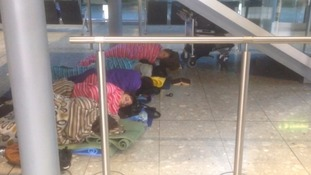 Passengers slept on the floor of Heathrow Airport on Sunday night.