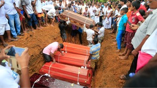 Villagers have begun burying the dead