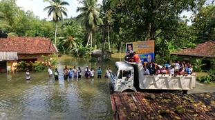 Sri Lanka floods and mudslides kill 165 people
