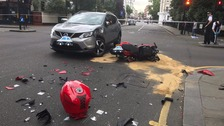 Motorcyclist and a car collided in Kensington.