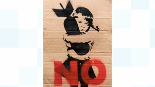 The placard was designed before Banksy became famous