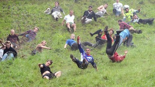 Over a thousand turn out for annual Cheese Rolling