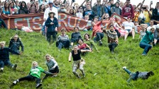 Over a thousand attend traditional cheese-rolling