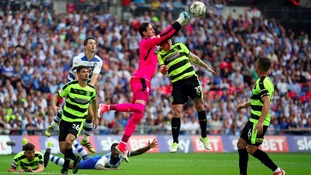 Danny Ward punches clear.