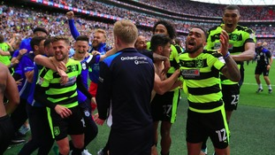 Huddersfield Town celebrate winning promotion.