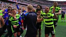 Huddersfield Town celebrate winning promotion.
