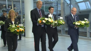 Transport Secretary Chris Grayling and Manchester Mayor Andy Burnham lay wreathes in tribute to the victims.