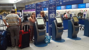 Shares in BA owner plummet as luggage chaos continues