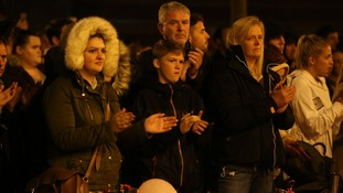 After a minute's silence was held at the vigil, the mourners broke out in applause.
