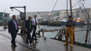 Theresa May greets a fisherman in Plymouth this morning