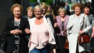 Judith Conduit (second from left) arrives with other victims at Nottingham Crown Court.