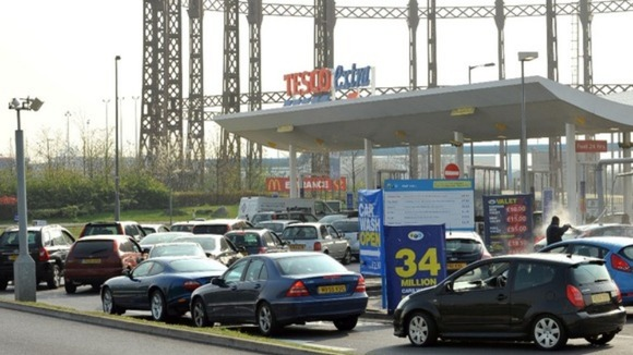 Cars queue for fuel at a Tesco store in Ashford, Middlesex