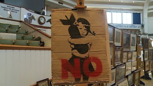 Cardboard Banksy sells for £10,000 at auction