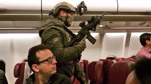 Armed police on the plane.