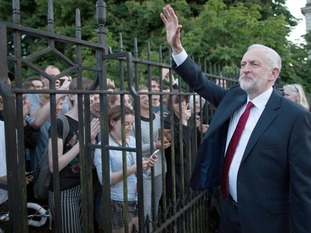 Labour leader Jeremy Corbyn waves to supporters after taking part in the BBC Election Debate
