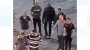 Can you help identify these men?