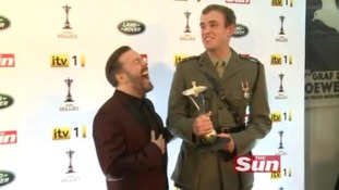 Ricky Gervais with Si Maxwell, winner of the Overcoming Adversity award