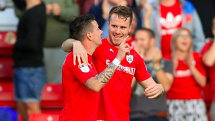 Marley Watkins (right) celebrates scoring for Barnsley against QPR last season.