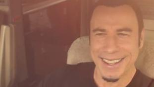 Travolta piloting a jet to meet Newton-John