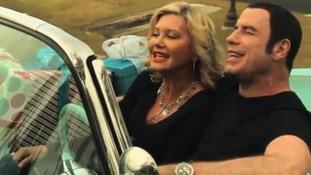 John Travolta and Olivia Newton-John sing their way to Christmas