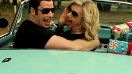 John Travolta and Olivia Newton-John sing their way to Christmas