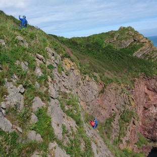 Two Coastguards on a cliff