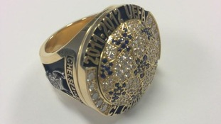Each gold, diamond and sapphire ring is individually inscribed for each player.