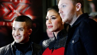 X Factor judge Nicole Scherzinger with finalists James Arthur, right, and Jahmene Douglas during a photocall at Manchester Central.
