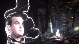 Tearful Robbie Williams dedicates Angels to Manchester attack victims