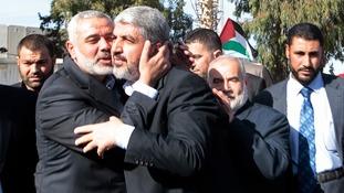 Senior Hamas leader Ismail Haniyeh kisses Hamas chief Khaled Meshaal in Rafah today.